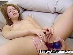 Busty amateurs Kira and Holly playing with dildos