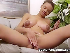 Busty Gia strips and playing her pussy
