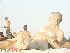 Hot babes filmed lounging on a nudist beach 3