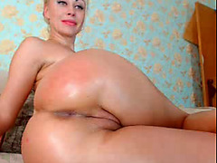 Watching blonde amateur playing with anal dildo