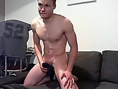 Sweet dude is beating off in the guest room and shooting himself on computer webcam
