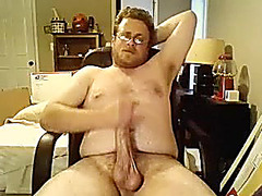 Winsome male is relaxing in the bedroom and memorializing himself on webcam