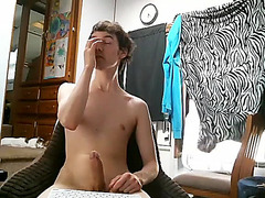 Alluring boy is frigging in a small room and memorializing himself on computer webcam
