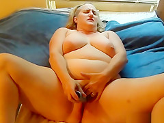 Fat Shaved Pierced MILF Uses A Vibrator For Her Snatch