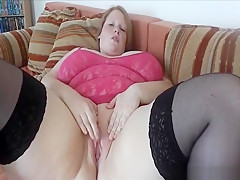 Fat slut in black stockings rubbing her shaved pussy on webcam