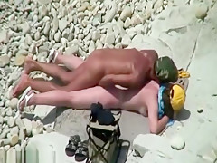 Interracial fuck action on the beach