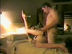 Wife fucks herself with a long dildo whilst her husband takes her ass