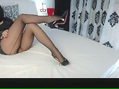 Mistress strips naked and teases with her feet and body