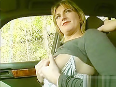 Stripping and rubbing her pussy in the car - Sascha Production