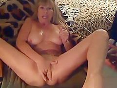 Oiled mature KlittyKat masturbates her pussy