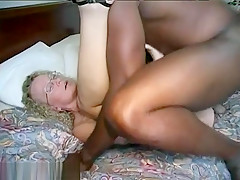 Horny granny enjoys a big hard black cock in her pussy