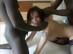 Slutty brunette babe enjoys two big black cock in threesome