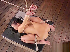 Hot ebony in hogtie gets trottle