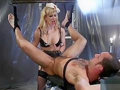 Blonde nurse in latex anal bans slave