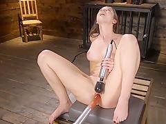 Laid in bondage brunette takes machine