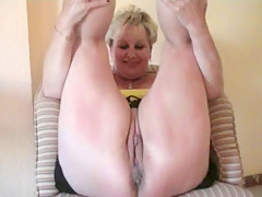 Hot MILF spreads her legs and teases her twat so everyone can see