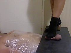 Ball Trampling with boots and socks, with throat and facetrampling
