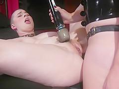 Mistress anal fucks shaved headed sub