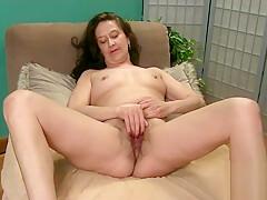 Cherise rubs her feet hairy pussy