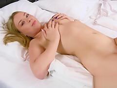 Blonde hottie pleasing herself in bed