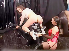 lesbian spanking in leather upholstery