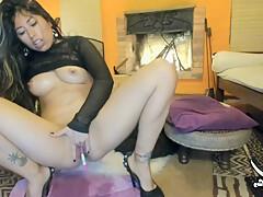 Latina camgirl fingering her butt