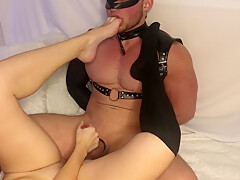 He sniffs her socks and feet and licks his cum off them
