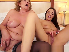 Busty lesbians pleasuring each others pussy