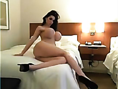Busty whore strips on a webcam show
